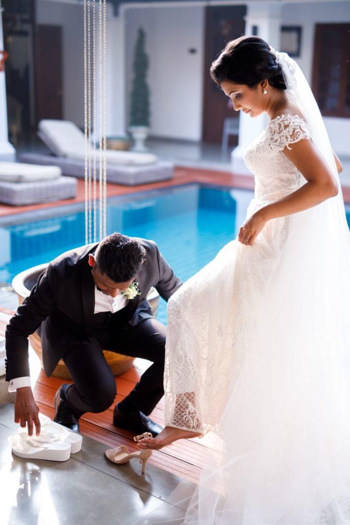 Photo Session opportunity when husband slips new Bride's Bridal Flip Flops onto her feet
